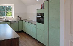 Küche Arbeitsplatte Beton mit Holz Fronten