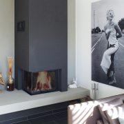 Raumteiler Kamin mit Kaminbank aus Beton