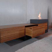Wohnzimmer Sidebord aus Beton mit Holz und Feuer